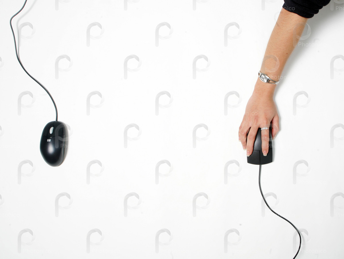 Woman's hand on a computer mouse against white backgroud